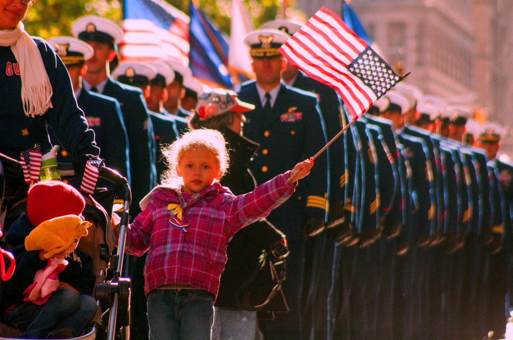 US Coast Guard families and service members march in New York City's Veterans Day Parade
