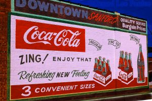 Drink Coke Ad. Restored On Brick Wall Image Credit: Donald Lee Pardue Image Improved at NJMassages.COM Uneding Health Quest Article August 2018